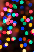 Glowing Christmas lights background in soft focus — Stock Photo