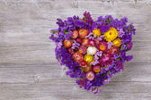 Heart shaped flower wreath — Stock Photo