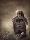 Crow sitting on a gravestone — Stock Photo