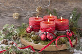 Four christmas candle — Stock Photo