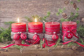 Four red christmas candle  — Stockfoto