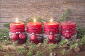 Four red christmas candle — 图库照片