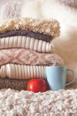 Stack of cozy knitted sweaters — Stock Photo
