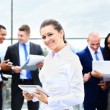 Business lady with positive look and cheerful smile posing for the camera — Stock Photo #55562855