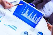 Financial paper charts and graphs on the table — Stock Photo