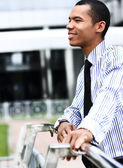 Peaceful african american businessman outdoor — Stock Photo
