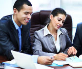 Image of business partners discussing documents and ideas at meeting — Stock Photo