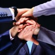 Closeup of business team putting their hands on top of each other — Stock Photo #66073533