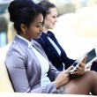 Businesswomen With Digital Tablet Sitting In Modern Office — Stock Photo #66074469