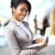 Beautiful young african american businesswoman working on computer — Stock Photo #66074543