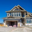 Suburban estate home under construction — Stock Photo #52930765