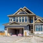 Suburban estate home under construction — Stock Photo #52930765
