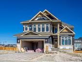 Suburban estate home under construction — Stock Photo