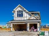 Suburban estate home under construction — Stock Photo