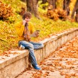 Young man with tablet and talking on the phone in outdoor — Stock Photo #52941535