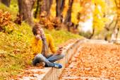 Young man with tablet and talking on the phone in outdoor — Stock Photo