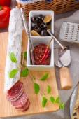 Pur porc salami and antipasti — Stock Photo