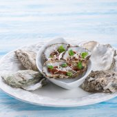 Oysters with parmesan — Stock Photo