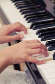 Playing on piano — Stock Photo