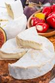 Brie cheese and figs on wooden board — Stock Photo