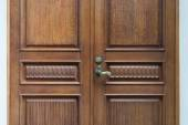The door is made of carved wood with a vintage a handle — Stock Photo