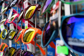 Sunglasses for sale at the booth — Stock Photo