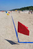 Red flag on the football pitch on the beach — Stock Photo