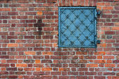 Brick wall with an old metal door — Stock Photo