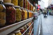 Jars with marinated and pickled vegetables at the market — Stock Photo