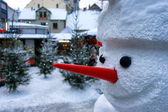Snowman with a red nose in the city on Christmas and New Year — Stock Photo
