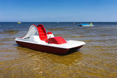 Red dinghy on the golden beach of the Baltic Sea — Stock Photo