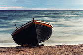 Wooden boat on the beach — Stock Photo