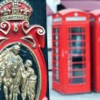Postal Service and a red telephone booth in London — Stock Photo #64199019
