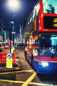 The red double-decker bus in the evening London — Stock Photo