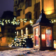 Lantern with a candle on a Christmas fair — Stock fotografie #64839055