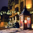 Lantern with a candle on a Christmas fair — Stok fotoğraf #64839055