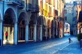 Bike on the street arcades in the early morning in Mantova — Stock Photo