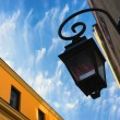 Street lamp on the front of the building on a background of clou — Stock Photo #70582099