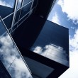 Aggressive angles of a modern building made of glass with reflec — Stock Photo #71718235