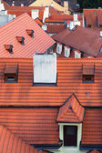 Red tiled roofs of different buildings in Prague — Stock Photo