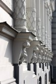 Colonnade on a building with decoration head lion — Stock Photo