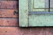 Fragment of wooden shutters on an old house wall — Stock Photo