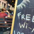 The inscription on the free WiFi at an outdoor cafe. Blurry — Stock Photo #74225023