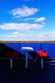 Red chairs on the ferry and the blue sky — Stock Photo