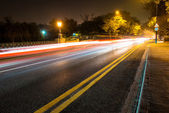 Night road in the city with car the light trails — Zdjęcie stockowe