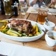 Traditional czech dinner with roasted pork leg and beer at the restaurant — Stock Photo #70006175