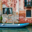 Venice cityscape, boat on narrow water canal near colorful wall with window — Stock Photo #70007555