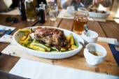 Traditional czech dinner with roasted pork leg and beer at the restaurant — Stock Photo