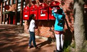 Girl dropping a letter in postbox — Stock Photo