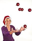 Santa girl throwing christmas balls — Stock Photo